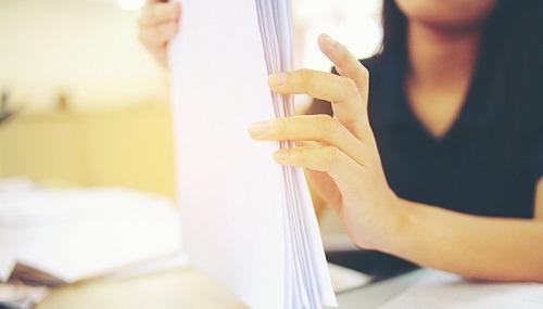 Licensing-Woman-Papers-1_500x285.jpg